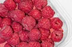 Fresh raspberries for sale. Fresh raspberries in plastic packaging Stock Image