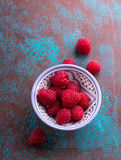 Fresh raspberries. Small ceramic bowl with heap of fresh red raspberries Royalty Free Stock Images