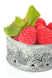 Fresh raspberries in small delicate metal casket over white Royalty Free Stock Image