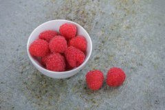 Fresh Raspberries. Small White China Bowl Filled with Fresh Raspberries on a Slate Board Royalty Free Stock Image