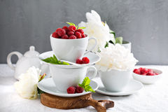 Fresh raspberries in stacked cups Stock Photos