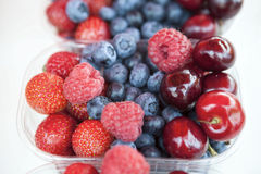 Fresh , raspberries, strawberries, cherries, blueberries in the box on the market Stock Photography