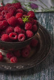Fresh  raspberries in vintage basket, vitamins, healthy food, ve. Gan ingredients. Selective focus Royalty Free Stock Photo