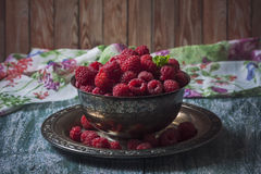 Fresh  raspberries in vintage basket, vitamins, healthy food, ve. Gan ingredients. Selective focus Royalty Free Stock Images
