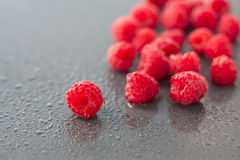 Fresh raspberries  on wet surfaces Royalty Free Stock Photography