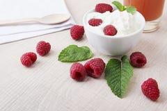 Fresh raspberries with whipped cream. Fresh juicy raspberries, whipped cream and juice Royalty Free Stock Photo
