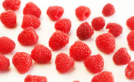 Fresh raspberries on white background. Fresh raspberries scattered on white background Stock Photography