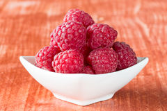 Fresh raspberries in white bow. Stock Photos