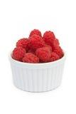Fresh raspberries in white bowl. On the white background Stock Photo