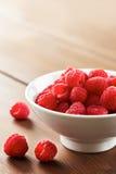 Fresh raspberries in white bowl Royalty Free Stock Image