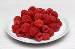 Fresh raspberries. In white dish Stock Photo