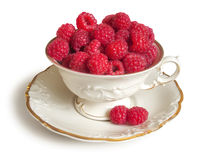 Fresh raspberries and white porcelain set Royalty Free Stock Images
