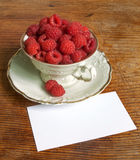 Fresh raspberries and white porcelain set Royalty Free Stock Photos