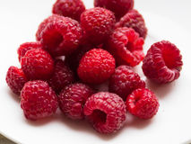 Fresh raspberries on a white saucer Stock Image