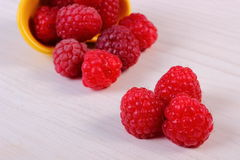 Fresh raspberries on white wooden table, healthy food Stock Photography