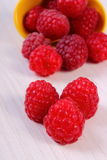 Fresh raspberries on white wooden table, healthy food Royalty Free Stock Photo
