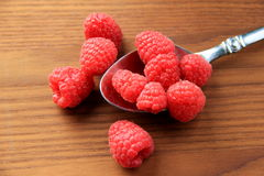 Fresh raspberries on wood backgruond Royalty Free Stock Image