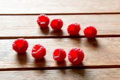 Fresh Raspberries. On wooden background Stock Photography