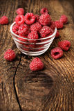 Fresh raspberries on a wooden background. Closeup Stock Image