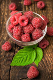 Fresh raspberries on a wooden background. Closeup Royalty Free Stock Image