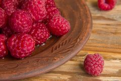 Fresh raspberries close up. Fresh raspberries on a wooden background, closeup Stock Images
