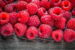 Fresh raspberries on wooden background.  Royalty Free Stock Photo