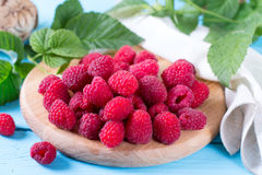 Fresh raspberries on a wooden background Stock Image