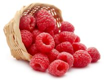 Fresh Raspberries. In a wooden basket over white background Royalty Free Stock Photo