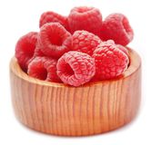Fresh Raspberries in a wooden bowl. Over white background Stock Image