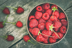 Fresh raspberries in wooden bowl. On grey rustic wooden background. Top view Stock Photography