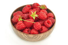 Fresh raspberries in wooden bowl. Isolated on white background Royalty Free Stock Photos