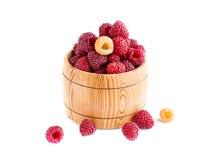Fresh raspberries in wooden bowl. Fresh raspberries in a wooden bowl on a white background Royalty Free Stock Photography