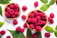 Fresh raspberries in wooden bowl on white table. Stock Photography