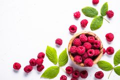 Fresh raspberries in wooden bowl on white table. Top view Stock Photography