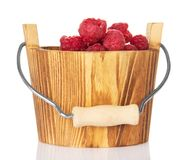 Fresh raspberries in a wooden bucket Royalty Free Stock Image