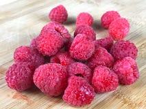Fresh Raspberries on Wooden Cutting Board. Fresh raspberries on a cutting board Stock Photos
