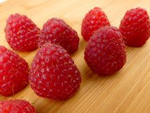 Fresh raspberries  on wooden plank. Close up Royalty Free Stock Photo