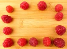 Fresh raspberries  on wooden plank close up. Fresh raspberries  on wooden plank Stock Image