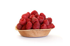 Fresh raspberries in the wooden platen  on white. Background Royalty Free Stock Image