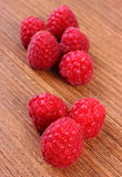Fresh raspberries on wooden surface, healthy food Royalty Free Stock Image