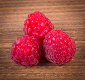 Fresh raspberries on wooden surface, healthy food Royalty Free Stock Photos