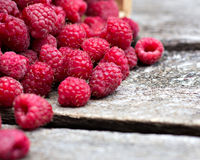 Fresh raspberries. On a wooden table Stock Photography