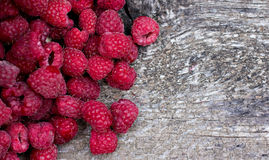 Fresh raspberries. On a wooden table Stock Images