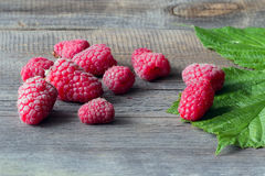 Fresh raspberries on wooden table.  Stock Image