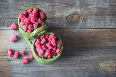 Fresh raspberries on wooden table.  Stock Photos