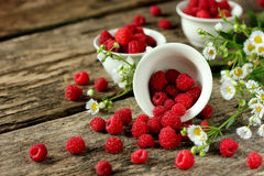 Fresh raspberries on a wooden table Stock Photo