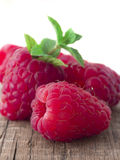 Fresh raspberries on wooden table Stock Image