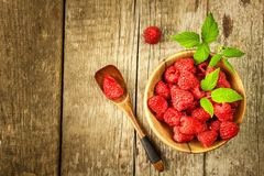 Fresh raspberries on a wooden table. Forest fruit. Healthy food. Sale of raspberries. Fresh raspberries on a wooden table. Forest fruit. Healthy food. Sale of Royalty Free Stock Photos