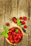 Fresh raspberries on a wooden table. Forest fruit. Healthy food. Sale of raspberries. Fresh raspberries on a wooden table. Forest fruit. Healthy food. Sale of Royalty Free Stock Images