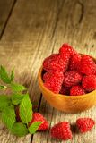 Fresh raspberries on a wooden table. Forest fruit. Healthy food. Sale of raspberries. Fresh raspberries on a wooden table. Forest fruit. Healthy food. Sale of Stock Images